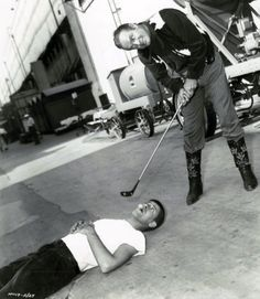 Bob golfing over Jerry Lewis