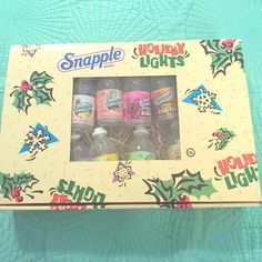 **SALE** Vintage Snapple bottle string lights Includes ten miniature Snapple bottles, wash with a different label! And a set of colored lights. Brand new! Snapple bottles approx. 3 in x 1 in. Other