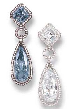 A SPLENDID PAIR OF FANCY VIVID BLUE DIAMOND AND DIAMOND EAR PENDANTS Price realised CHF 1,300,000 USD 1,120,835 Estimate CHF 1,050,000 - CHF 1,550,000 (USD 905,290 - USD 1,336,381)