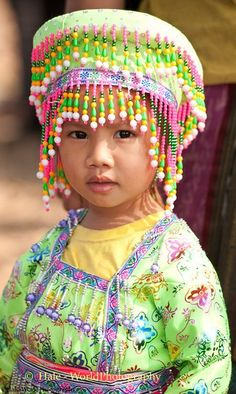 Young Hmong Girl in Traditional Clothing at New Year's Festival in Lao People's Democratic Republic / Hale- World Photography