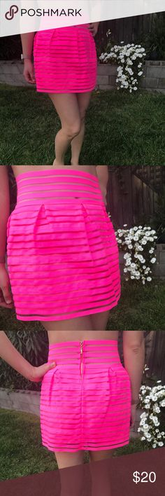 NWT San Joy Neon Pink Mini Skirt 80's New with tag neon pink skirt   In Asian sizes so runs smaller- it fits a x-small - small but says large.   There is a small pull in the thread but it's so unnoticeable that I couldn't pick it up with the camera. Material is a bit wire-y feel so the pulling won't continue.   Great for 80's party, Coachella, music festivals, etc!   Let's make a deal 🤝  Sharing is caring! 💁🏽‍♀️💕 San Joy Skirts Mini