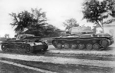 KV-1 heavy Tank passes the knocked out PZkpfw 3 on the way to Berlin