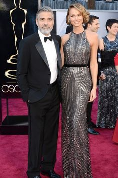 George Clooney with Stacey Kiebler in Armani at the Oscars 2013 | Mamamia.com.au