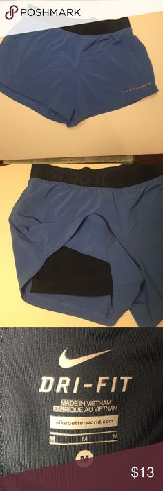 NIKE Dri- Fit running shorts These Nike running shorts have black shorts underneath. The elastic around the waist has the Just Do It mark. Nike Shorts