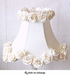 This elegant bell-shaped, scalloped kids lamp shade is made with the finest cream Dupioni Silk and adorned with rows of gorgeous large cream Mulberry paper roses. This girl's lamp shade is the perfect