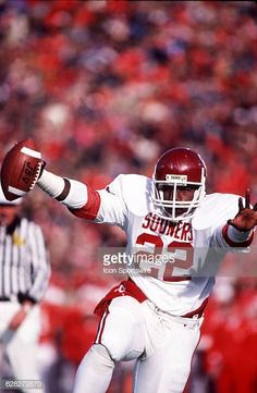 Running back Marcus Dupree of the Oklahoma Sooners scores a touchdown during the Sooners 2824 loss to the Nebraska Cornuskers at Memorial Stadium in. Semi Pro Football, College Football Players, Fall Football, School Football, Football Helmets, Football Parties, Oklahoma Sooners Football, Oregon Ducks Football, Notre Dame Football