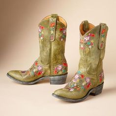 """Particularly well-suited to the season, Old Gringo's artisanal cowgirl boots are handmade in supple green distressed leather, embroidered at the vamp, heel, shaft and side tabs with vibrant blooms. Whole and half sizes 6 to 10, 11. 1-3/4"""" canted heel.View our entire Old Gringo Collection."""