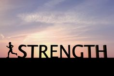 The word strength is silhouetted against a bright sunset sky. To the left of the word is a single human figure running towards the left of the image. The sky is orange at the bottom changing to blue at the top, there are some clouds in the sky.