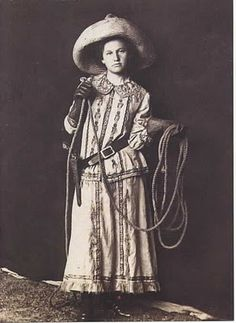 c. 1890 ... unknown cowgirl posing with lariat and a holstered, rather long barrel six-shooter.