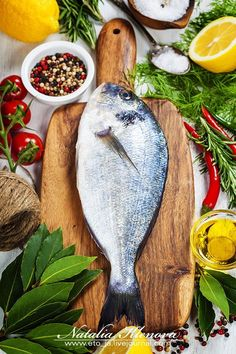 Cooking fish - fresh dorado fish and vegetables on wooden board - food and drink Asian Fish Recipes, Recipes With Fish Sauce, Whole30 Fish Recipes, White Fish Recipes, Easy Fish Recipes, Gefilte Fish Recipe, Ono Fish Recipe, Parmesan Fish Recipe, Cooking