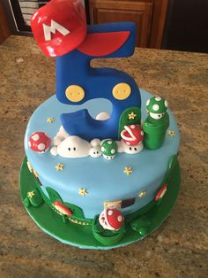 This Mario Bros Theme Birthday Cake became the perfect center piece for the dessert table we created. Ask us about our custom sweet creations at contact@cakebashstudio.com