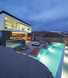Contemporary two story stone beach house