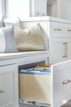 Organized and Functional Office Supply Drawers - Kelley Nan- Filing Cabinet Drawer Under Window Seat in Office Built-Ins