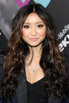 I love Brenda Song's hair! Black with brown highlights, long, curly!