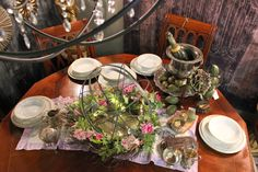 Entertain with vintage china and a pretty centerpiece created with HomeGoods orb and wreath! #pretty #dining #centerpiece #sponsored