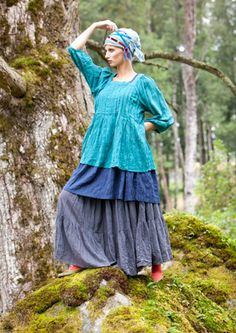 I like loose flowing long dresses and skirts to float along in a place where dreams and visions are made manifest...