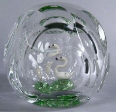 Swan in the Pond, a 1973 Perthshire Paperweight, Crieff, Scotland. Large clear faceted weight with concave top, star cut base, inlaid with green 'pond' ring and optic inner dome, inlaid tiny white swa