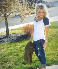 American Eagle jeans and top Army jacket in hand