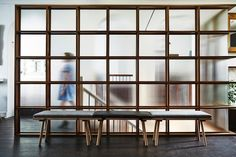 Love this wood and glass partition wall in the Aviary Hotel in Melbourne via Remodelista