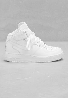 NIKE A modern take on Nike's popular AF-1, these basketball style sneakers have a modern silhouette, a velcro ankle strap, and ankle cushioning.