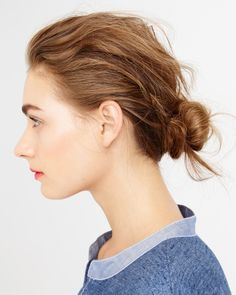 4 Gently twist hair at the nape of the neck and coil it counterclockwise into a bun 5 Pin hair on either side of the bun, allowing loose wisps to escape 6 Spray all over with Sachajuan Hair Spray to hold in place 2015  J.Crew Blog