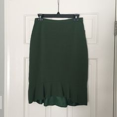 Anthropology Pencil Skirt with Ruffle Hem NWT! Dark green pencil skirt from Anthropologie. The skirt has a flirty ruffle hem that makes it fun and sexy. Anthropologie Skirts Pencil