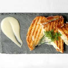 Jaleo; Washington, DC  Megawatt Spanish chef José Andrés takes a haute approach to grilled cheese during lunch at his experimental tapas bar. The sandwich features a lavish mix of imported Manchego, Murcia, Valdeón, goat cheese and truffle oil, plus beautiful golden grill marks