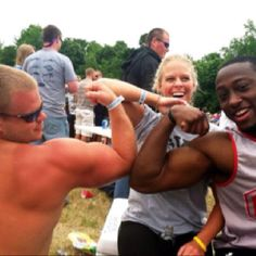 Kenny and Sarah and friend showing off muscles