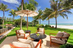 """Named for the Sanskrit word meaning """"paradise,"""" Villa Nandana has panoramic views over the turquoise waters of the Andaman sea and is just a few barefoot steps from the white sands of Natai Beach."""