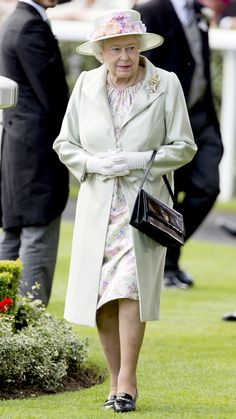 Queen Elizabeth accented her a cream-colored hat and Angela Kelly coat with pastel florals as she watched her horse Musical Comedy compete on day 2 at Royal Ascot 2014