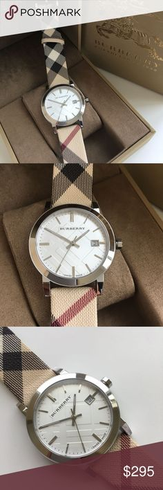 New Burberry Swiss Nova Check Ladies Watch BU9022 BRAND NEW BURBERRY IN THE ORIGINAL BOX.   Burberry BU9022 Women's Swiss Nova Check Fabric Strap White Dial Watch.  Dial window material type : Sapphire Crystal Display Type : Analog Case material : Silver Tone Stainless Steel Case diameter : 38 millimeters Water resistant depth : 50 Meters Burberry Accessories Watches