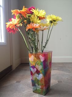 You'll need: Mod Podge, a paintbrush, multi-colored tissue paper and a vase.