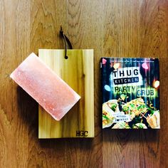 The Thug Kitchen gift box from Happy Gift company includes their latest book, Party Grub. The gift set also includes a handmade chopping block made from one solid piece of poplar wood and finished with a leather hanging strap, as well as a Himalayan salt block that is perfect for chopping, and grilling vegetables. This is a vegan gift set. Happy Gift Company offers free shipping in the USA.