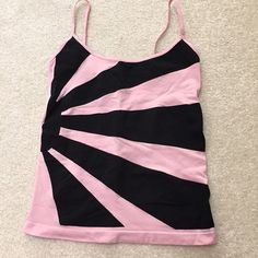 Bebe colorblock seamless camisole Bebe seamless camisole. No snags. Tags cut out because they bothered me. Will fit XS or S. bebe Tops Camisoles