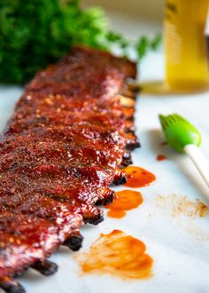 Dry rubbed first, these St. Louis Style Ribs get basted with apple juice, wrapped and then basted again with BBQ sauce for that fall off the bone, tender rib. Rib Recipes, Entree Recipes, Grilling Recipes, Cooking Recipes, Bbq Ribs In Oven, Oven Baked Ribs, Grill Oven, Bbq Grill, Smoked St Louis Ribs