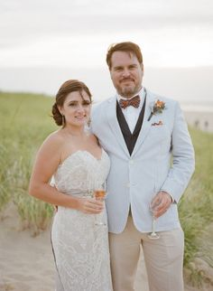 Bride In A Lace Wedding Dress And The Groom Seerer Suit With