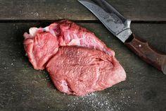 Raw steak with salt