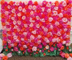 Flower Wall Photo Backdrop - hundreds of hand-made tissue paper flowers.  Took over two weeks to make, but worth every second!