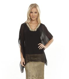 This top is very elegant - If you have to wear something formal, it doesn't have to be stuffy and uncomfortable! Put a black tank under this and you are set.