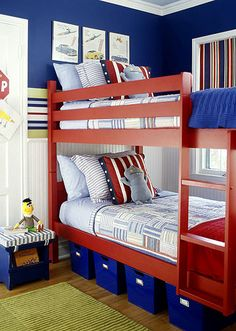 Bedroom Colors Blue And Red with floor-length blue curtains and red and navy bedding, this