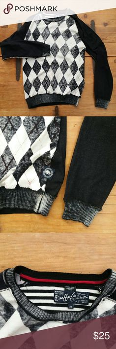 Buffalo David Bitton Modern Argyle Sweater Black and white argyle print sweater men's long sleeve shirt.  Features red accents and distressed assembly.  100% cotton sweater knit. Printed graphic on one sleeve near shoulder. This top is printed on the inside so the outside has a cool distressed look. Raw edges at Rib. Velvet neck tape. Branded labels Buffalo David Bitton Shirts Sweatshirts & Hoodies