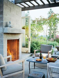 Pull Up a Chair and enjoy an outdoor fireplace under a pergola! BHG