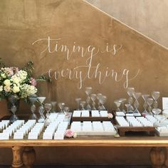 Sometimes timing is everything.. hourglasses with calligraphy from @wondrous_whimsy and @thepointednib for our back wall with blooms by @toastsantabarbara #amorology #noelandcamwedding