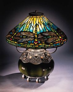 "A rare and magnificent ""Dragonfly"" leaded glass, stone, bronze and blown glass table lamp. Tiffany Studios, with beaded finial the oil canister stamped TIFFANY STUDIOS NEW YORK. Tiffany Stained Glass, Stained Glass Lamps, Tiffany Glass, Fused Glass Art, Leaded Glass, Louis Comfort Tiffany, Antique Lamps, Vintage Lamps, Rustic Lamps"