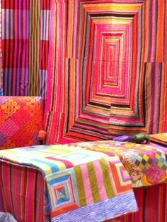 affe Fassett booth at Quilt Market  I'd say this room has attitude, then again it's Kaffe, nat. it does!