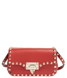 Signature studs lend a touch of rock-star glamorous appeal to this eye-catching, red-hot Valentino purse.