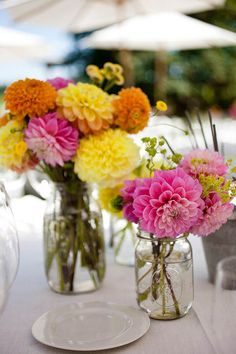 another magnificent centerpiece idea---- mason jars!!!!!!! So southern :) with dahlias