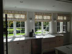 """This is a Martyn Lawrence-Bullard fabric """"Sultan's Garden"""" made into roman shades for kitchen windows."""