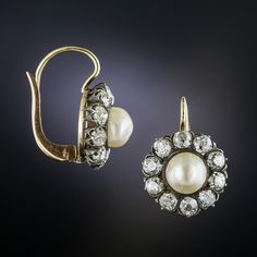 Dating back to the second half of the 19th century, these rare original earrings, hand fabricated in silver over 18K gold, encircle a pair of lustrous natural pearls with 2.75 carats of bright white and sparkling old mine-cut diamonds. Lever backs.