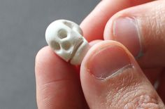 How to make polymer clay skull beads!  Fabulous!